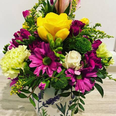 Bunch of flowers in a floral design pot